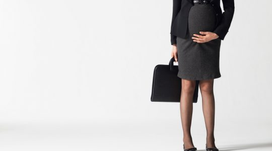 Lowsection Of Pregnant Businesswoman With Briefcase