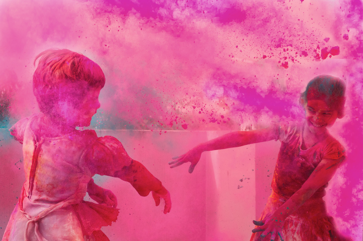 Two little kids playing with gulal on holi.