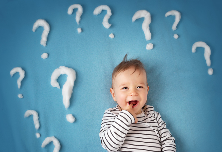 funny little boy with lots of question marks