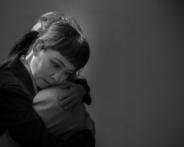 Women are embracing with sad emotions.