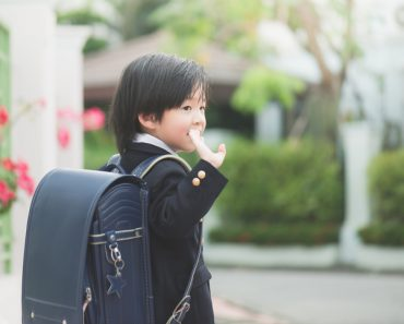 student going to school and waving goodbye