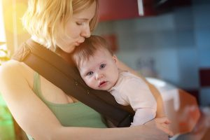 bigstock-Mother-carrying-baby-in-sling-15798881