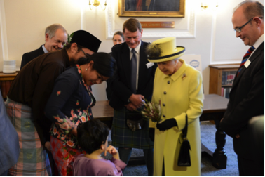 Khairun Nisa and family with Her Majesty Queen Elizabeth II. Photo republished with permission.