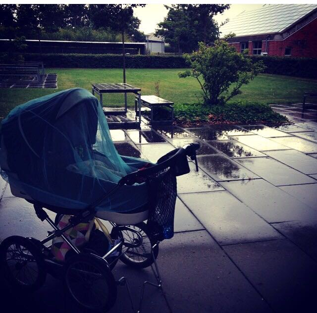 Summertime in Denmark and nap time in the rain. The sound of the rain around the pram calms him - Photo courtesy of Karin Rosen