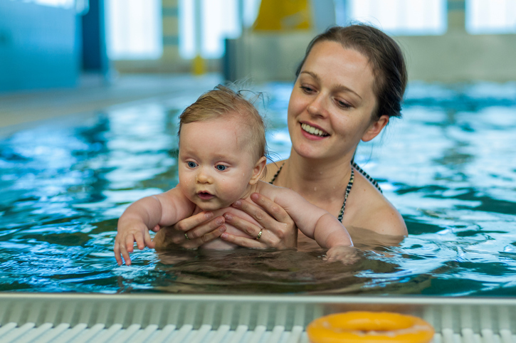 Baby with mother in a swimming pool