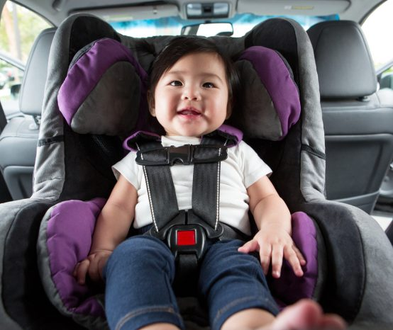 Should child car seats be installed at the back or front?